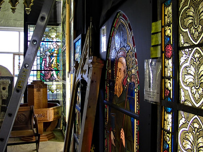 A typical corner of the mill, this one packed with stained glass salvaged from a dead church.
