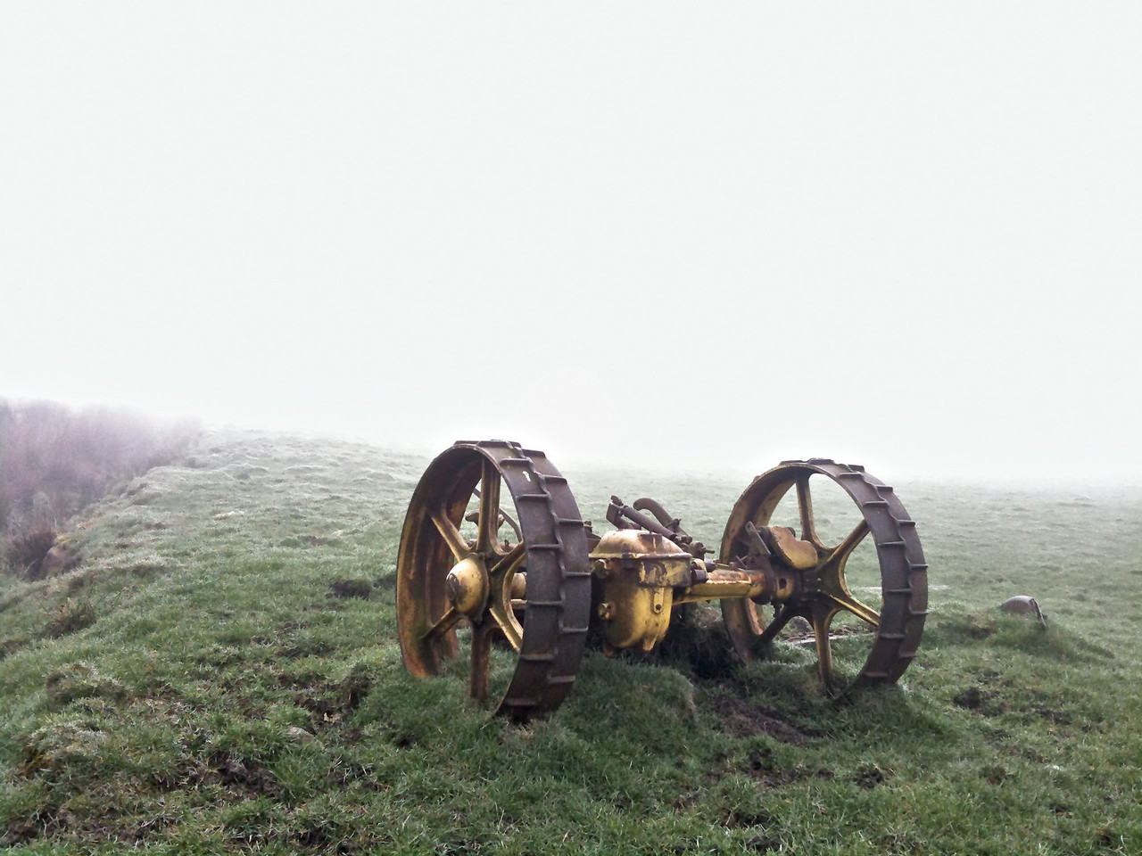 Disused farm machinery in the fog above Riddlesden. iPhone.