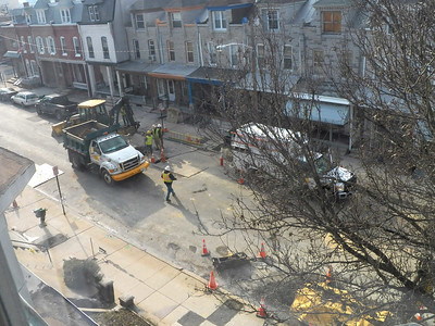UGI (gas company) crew tearing up my street to install new meters, January 2015