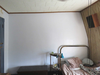 freshly painted bedroom wall, with shelves removed, September 2016