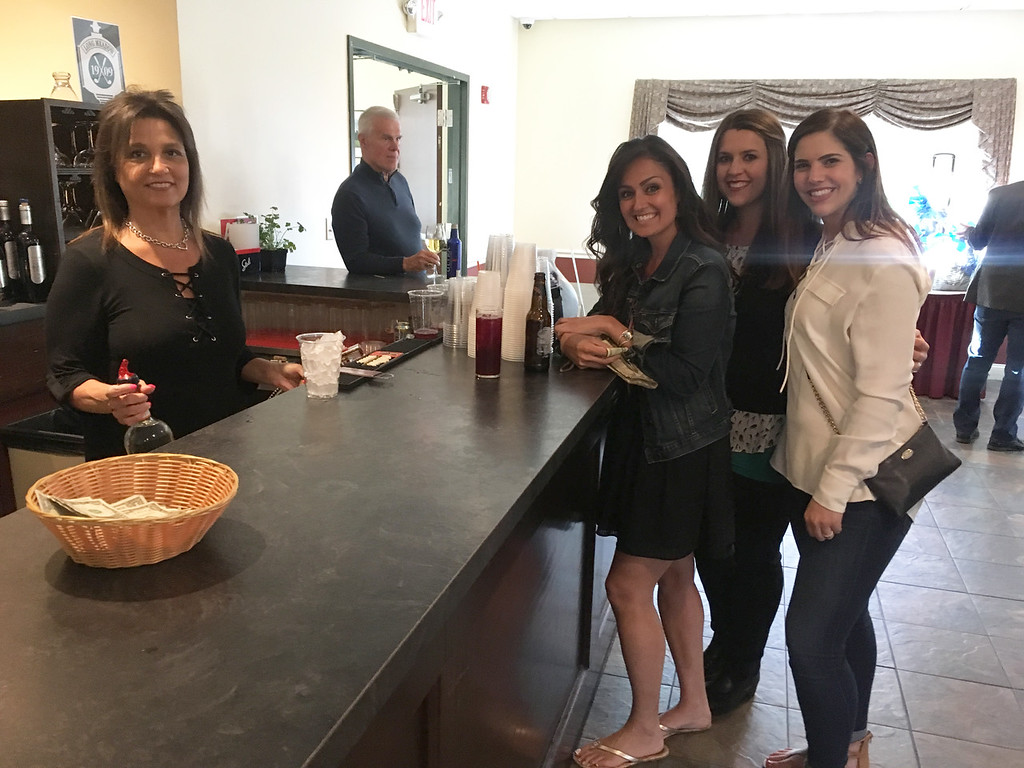 . From left, Long Meadow bartender Maria Cunha of Chelmsford serves Jennie Flood of Tyngsboro, Tia Ouellette of Lawrence and Sarah Tyburski of Haverhill.