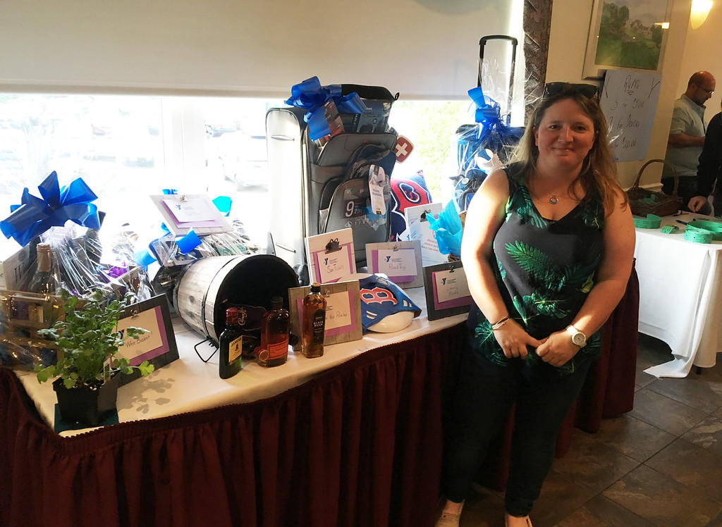 . Erin Herbert of Hudson, N.H., with raffle prizes