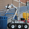 KRISTI GARABRANDT - THE NEWS-HERALD<br /> <br /> The lake County Bomb Squad remotely operates the bomb removal robot during mass casualty training.  The Bomb squad is attempting to maneuver the robot arm to remove a suspicious package from the garbage can at the entrance to Class Stadium.