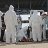 KRISTI GARABRANDT - THE NEWS-HERALD<br /> <br />  Lake County Hazmat scans a dummy being carried out of Class Stadium on a stretcher to see if it can into any contact with chemicals as it goes through the decontamination stage set up.