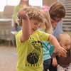 Eric Bonzar—The Morning Journal<br /> Four-year-old Mason Lagrotteria dances the afternoon away during the Elyria Public Library System's West River Branch Baseball Party, April 20, 2016.