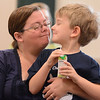 Eric Bonzar—The Morning Journal<br /> Five-year-old Spenser Wirth takes a juice break, and shares a smile with his mom, during the Elyria Public Library System's West River Branch Baseball Party, April 20, 2016.