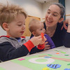 Eric Bonzar—The Morning Journal<br /> Two-year-old Dominic Clark goes with a nautical theme for his baseball-inspired craft during the Elyria Public Library System's West River Branch Baseball Party, April 20, 2016. Dominic came to the event with his mother Kate Clark and 7-month-old sister Emmeline Clark.