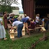 Chad Felton — The News-Herald <br /> Pioneer School campers and volunteers alike work together to build chairs at Century Village Museum in Burton Village. Other activities were also available during the camp, in its 45th year, such as spinning and weaving demonstrations and classes on prehistoric history.