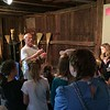 Chad Felton — The News-Herald <br /> Campers watch as prehistorian and program instructor Mike Fath holds a spearhead at Century Village Museum's 45th Pioneer School in Burton Village. Campers participated in a wide array of activities which embrace the customs of early Geauga County settlers.
