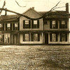 "Historic photo provided by North Ridgeville Historical Society <br> Alton Henry Mooers, who owned and operated the Ridgeville Chair Works factory nearby, built this large house in 1857 (shown here in 1931) on Center Ridge Road just east of the Congregational Church. After Mooers' death in 1909, the Dr. Isaac N. Oakes family bought it, and by 1920 operated the house as the ""Four Chimneys Inn,"" an early roadside motel or bed and breakfast. It was owned from the 1930s to 1950s by the Lasch family, and was torn down about 1970 for expanded church parking."