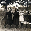 Historic photo provided by North Ridgeville Historical Society <br> The six daughters of Joseph and Rosina (Diederich) Pitts' family, lined up in order of age posing for the photographer (Father Joseph Trapp) in aobut 1916. Left to right: Veronica, Eleanor, Loretta, Irene, Lucella and Ardella Louise Pitts. Joseph and Rosina also had six sons: Bernard, Albert, Ralph, Norbert, Edmund, and Cyril, the last three of whom died in infancy. After Ridgeville was settled in 1810, many New England families came here to live, followed in the 1830s and 1840s by dozens of families from England in the southern part of the township, and German (and later Irish) Catholic settlers like the Pitts family, living mostly in the northern part, which led to the creation of St. Peter's Church in 1875.