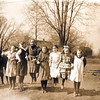 """Historic photo provided by North Ridgeville Historical Society <br> Students from Ridgeville's District Number One school playing jump rope around 1910 to 1915. The boys on either side are swinging the rope, which appears invisible in the long-exposure photograph. By the mid-1800s, Ridgeville Township had 10 distrrict schools before they were """"centralized"""" and replaced in 1923-24 when the new 12-grade high school (now the middle school) and Fields Elementary School (later called Fields-Sweet) were built. Note the Green Line trolley car tracks behind the children, in front of the District One school on Center Ridge Road, about where St. Peter's gymnasium stands today."""