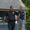 "Eric Bonzar—The Morning Journal<br /> Sheffield Village police Capt. William Visalden and an investigator from the Ohio Bureau of Criminal Investigation secure evidence near where the body of 26-year-old Stephen ""Antonio"" Dukes was found, Aug. 5, 2016. Dukes was found in the driveway of his Waterford Circle home by a newspaper delivery person around 4:30 a.m., Visalden said."