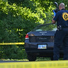 "Eric Bonzar—The Morning Journal<br /> An investigator for the Ohio Bureau of Criminal Investigation takes photos near the area where the body of 26-year-old Stephen ""Antonio"" Dukes was found, Aug. 5, 2016."