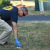 "Eric Bonzar—The Morning Journal<br /> An investigator for the Ohio Bureau of Criminal Investigation marks evidence near the area where the body of 26-year-old Stephen ""Antonio"" Dukes was found, Aug. 5, 2016."