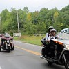 Kristi Garabrandt — The News-Herald <br> Riders from Rolling Thunder chapter one and Red Knights chapters one and nine escort the Semi-truck transporting the Wall That Heals from Observatory Park to Geauga County Fairgrounds where it will be on display from Sept. 8 - Sept. 11.