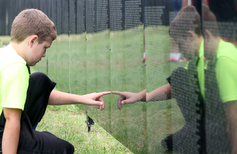 Kristi Garabrandt — The News-Herald <br> Jaxon Denver Cicchhella, 10, of Novelty is home-schooled and was brought to the wall by His Grandfather to show him how many names were on the wall and teach him the history behind it.