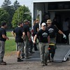 Kristi Garabrandt — The News-Herald <br> Geauga Park District staff and volunteers line up to unload the trailer and prepare to set up The Wall that Heals.