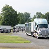 Kristi Garabrandt — The News-Herald <br> The Semi-Truck that transports the Wall that Heals Makes it way into the Geauga County Fairgrounds with its motorcycle escort. Image 4944
