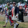 Kristi Garabrandt — The News-Herald <br> Members of the Sons and Daughters of The American Revolution present a wreath bearing a ribbon which says you are not forgotton during the opening ceremony.