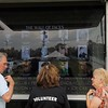 Kristi Garabrandt — The News-Herald <br> The mobile education center features three six foot digital screens that display the photos of Geauga County residents on the wall.