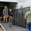 Kristi Garabrandt — The News-Herald <br> Geauga Park District Staff start to unload the panels of the Wall that heals.