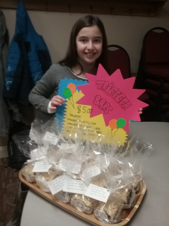 . Sofia Nekic stands ready to sell homemade Trifecta Bars at a bake sale coordinated by the fourth-grade classes of St. Gabriel School in Concord Township. Proceeds raised will benefit school children who were victims of Hurricane Harvey in Houston, Texas.  {Jean Bonchak for The News-Herald}
