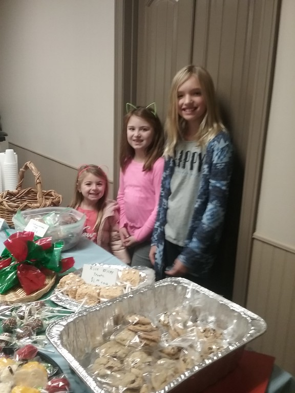 . Stella Palumbo, age 5, (l), along with St. Gabriel School fourth grade students Sophia Palumbo (c) and Gabriella Bedrick (r) were pleased to participate in the bake sale. {Jean Bonchak for The News-Herald}