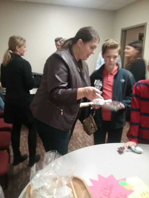 . Margie Koerwitz and son P.J. of Concord Township, St. Gabriel School fourth-grade student, assemble an assortment of baked goods to purchase. {Jean Bonchak for The News-Herald}