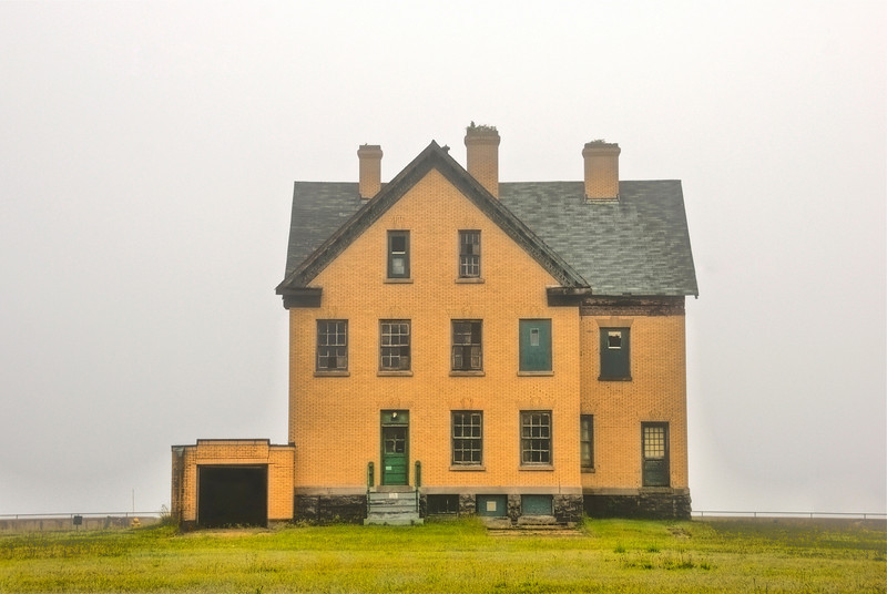 5/27/10 - Lone officer house from about 1900 is desperate need of repair.  This sits across the street from the bay but the heavy fog obscures the view