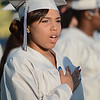 Eric Bonzar—The Morning Journal<br /> A graduate places her hand over her heart as she sings the national anthem during the 2015-16 Lorain High School Commencement Ceremony, May 24, 2016.