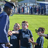 Eric Bonzar—The Morning Journal<br /> The Tiny Titan class of 2028 high-five the graduating seniors during the 2015-16 Lorain High School Commencement Ceremony, May 24, 2016.