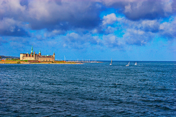 Castle Kronborg and sailing yachts on a sunny day