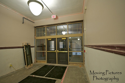 Hughes Renovations - Entrance beneath front stairs, leads to new alumni office location
