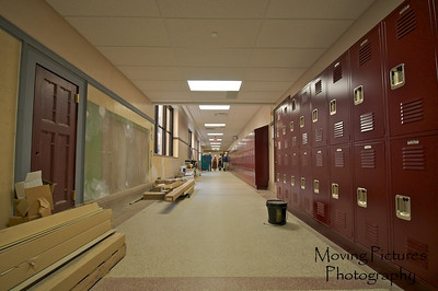Hughes Renovations - 1st floor south hallway: new ceiling, windows, lockers