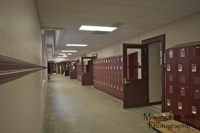 Hughes Renovations - Hallway with view of new doors and lockers
