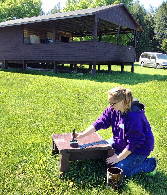 . Morrisville Leos Club member Sydney DeCock works to paint a bench  at Madison County Children Camp Camp Lookout on Saturday, May 23 2015.More than 20 students from Morrisville Eaton spent two days at the camp getting it ready to open for the summer. JOHN HAEGER-ONEIDA DAILY DISPATCH @ONEIDAPHOTO ON TWITTER