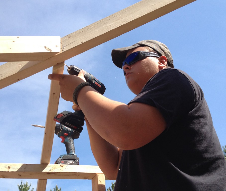 . Oneida carpentry student Frank Alberico works on the pool house structure on Friday, May 29, 2015. JOHN HAEGER-ONEIDA DAILY DISPATCH @ONEIDAPHOTO ON TWITTER