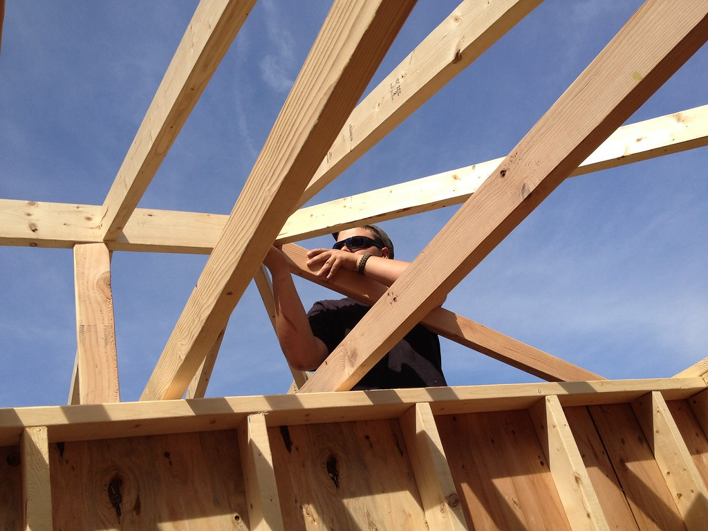 . Oneida carpentry student frank Alberico  works on the  roof line on the pool house structure on Friday, May 29, 2015. JOHN HAEGER-ONEIDA DAILY DISPATCH @ONEIDAPHOTO ON TWITTER