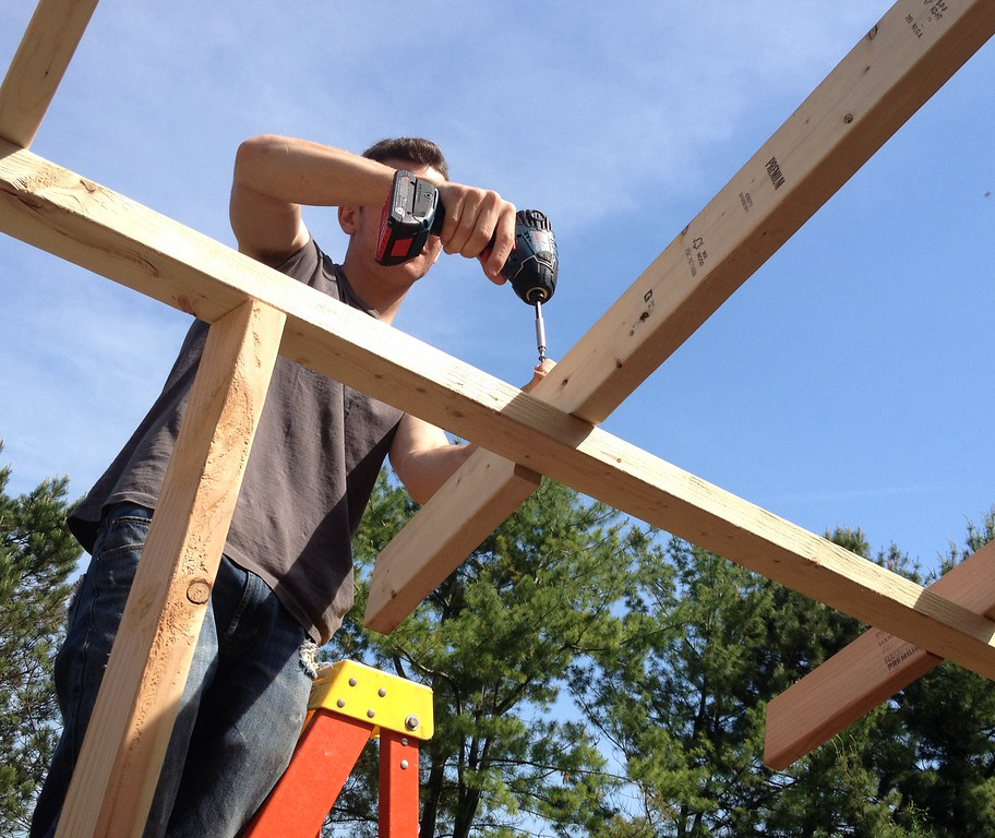 . Oneida carpentry student Dylan Webb works on the  roof line on the pool house structure on Friday, May 29, 2015. JOHN HAEGER-ONEIDA DAILY DISPATCH @ONEIDAPHOTO ON TWITTER