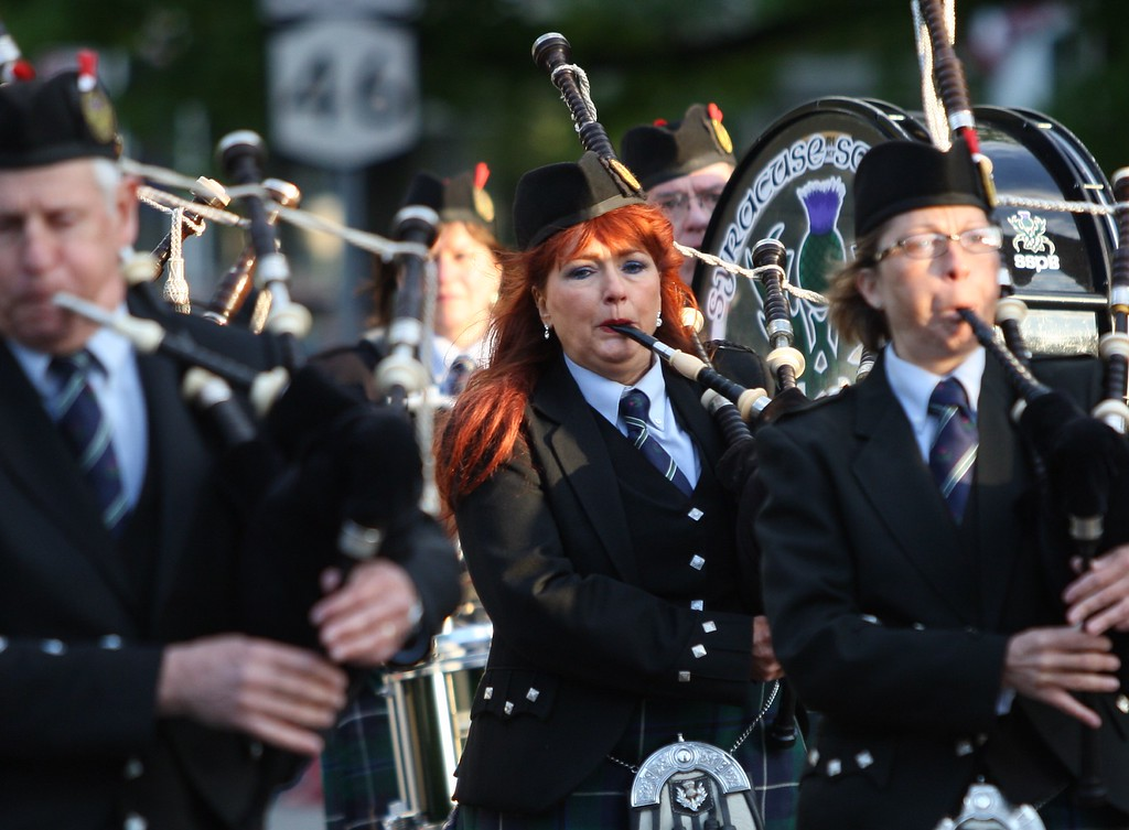 . Bag pipers make their way along Main Street in the city of Oneida during the Memorial Day parade on Friday. May 22, 2015. route JOHN HAEGER-ONEIDA DAILY DISPATCH @ONEIDAPHOTO ON TWITTER