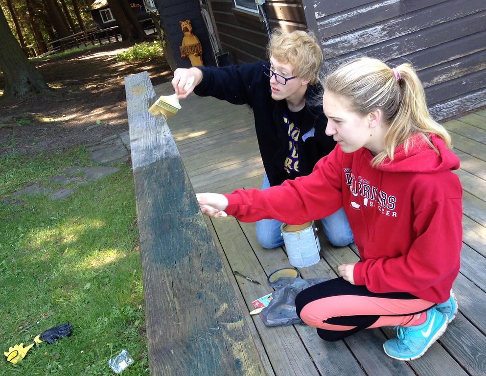 . Morrisville Leos Club members Gracie Baker and Nate DeCock work to stain a deck and railing at Madison County Children Camp Camp Lookout on Saturday, May 23 2015.More than 20 students from Morrisville Eaton spent two days at the camp getting it ready to open for the summer. JOHN HAEGER-ONEIDA DAILY DISPATCH @ONEIDAPHOTO ON TWITTER