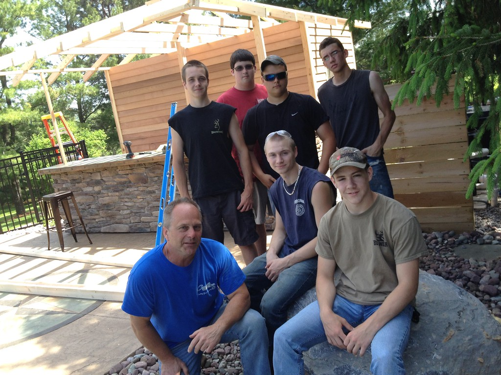 . Oneida Carpentry teacher  Bob Straczuk Zach Walker, Dustin Scribner, Tim Wimett, Jacob Snyder, Frank Alberico and Dylan Webb pose with the breakfast bar and pool house they are building in Manilus on Friday, May 29, 2015.JOHN HAEGER-ONEIDA DAILY DISPATCH @ONEIDAPHOTO ON TWITTER