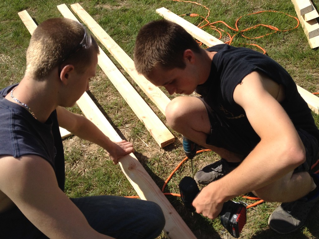 . Oneida carpentry students Zach Walker and Tim Wimett works on the pool house structure on Friday, May 29, 2015. JOHN HAEGER-ONEIDA DAILY DISPATCH @ONEIDAPHOTO ON TWITTER