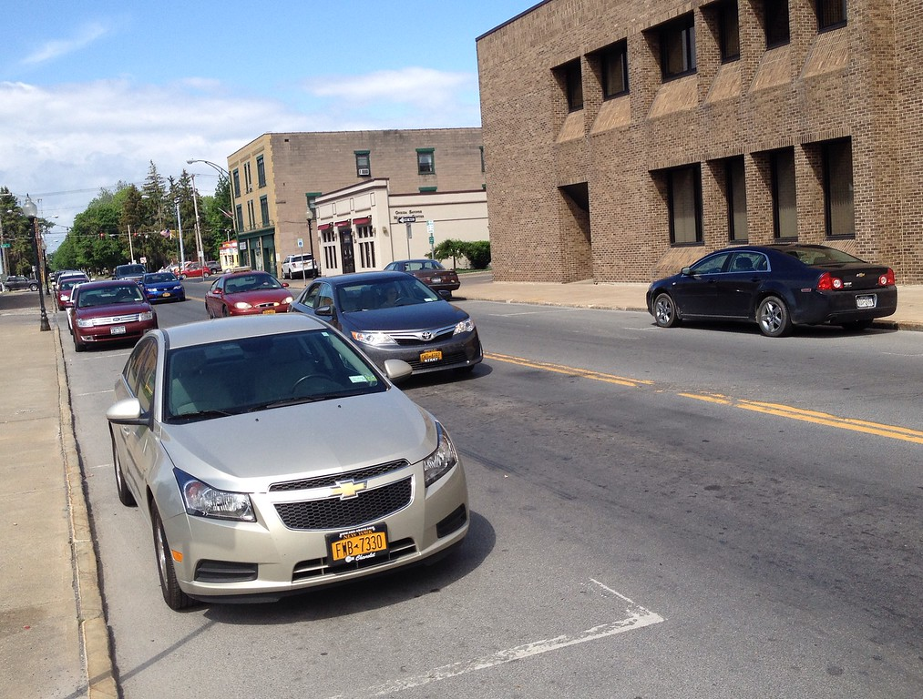 . Vehicles park along Lenox Ave in the city of Oneida on Thursday, May 28, 2015. Twenty three parking spaces on Lenox Ave between Main Street and Broad Street could be lost  if turning lanes are added in the planned reconstruction of the road. JOHN HAEGER-ONEIDA DAILY DISPATCH @ONEIDAPHOTO ON TWITTER