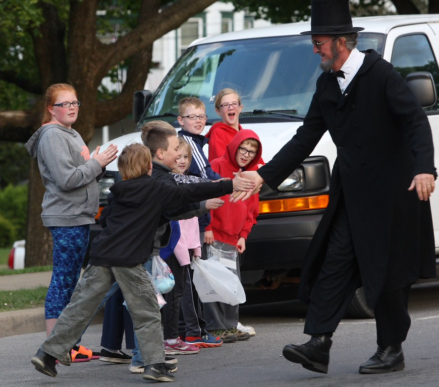 . President Abraham Lincoln reenactor Jack Baylis shakes hands with parader goers as he makes his way along Main Street in the city of Oneida during the Memorial Day parade on Friday. May 22, 2015. route JOHN HAEGER-ONEIDA DAILY DISPATCH @ONEIDAPHOTO ON TWITTER