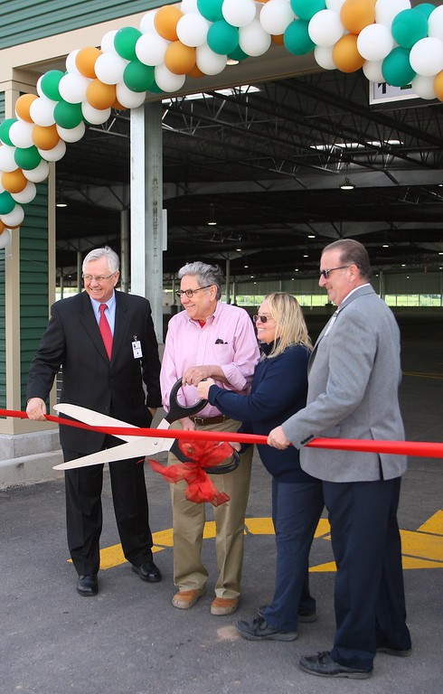 . Thomas Osiecki, Jeff Gural Paula Gural and Scott Freeman cut the ribbon to open the 222 space parking garage at Vernon Downs on Friday, May 22, 2015.JOHN HAEGER-ONEIDA DAILY DISPATCH @ONEIDAPHOTO ON TWITTER