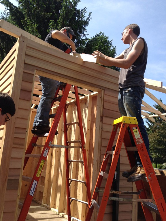 . Oneida carpentry students Frank Alberico and Dylan Webb work on the building the pool house structure on Friday, May 29, 2015. JOHN HAEGER-ONEIDA DAILY DISPATCH @ONEIDAPHOTO ON TWITTER