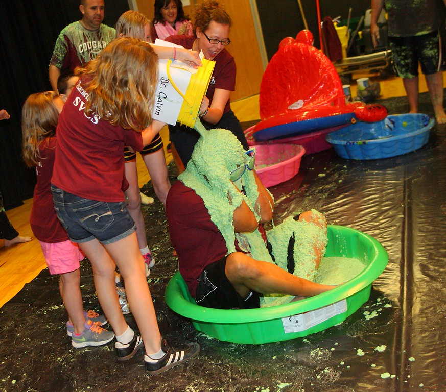 . Stockbridge Valley Elementary  Schools students pour green slime on Superintendent Mathis Calvin on Friday, May 29, 2015. students met the reading challenge and read more than 11,000 books.JOHN HAEGER-ONEIDA DAILY DISPATCH @ONEIDAPHOTO ON TWITTER