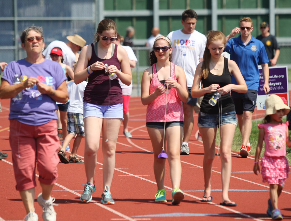 . Teams begin their laps  during  the annual Madison County Relay for Life on Saturday, May 30, 2015 at Oneida High School track.JOHN HAEGER-ONEIDA DAILY DISPATCH @ONEIDAPHOTO ON TWITTER